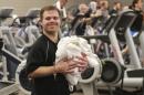 Justin Bainbridge working at the Prairie Life Fitness Center in Omaha, Nebraska (Photo: Nati Harnik/AP)