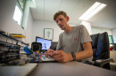 Matt Griswold '18 works at the Makerspace in the UNH ECenter