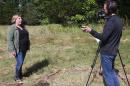 Meghan Howey being videotaped