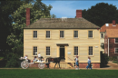 A carriage goes by the Lowd House in Strawbery Bank in Portsmouth, NH