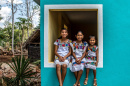Sisters Angela, 12, Gelmy, 9, and Alexa Natali, 3, sitting on a window sill in Valladolid, Mexico