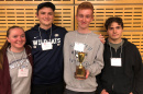 photo of four UNH students with trophy