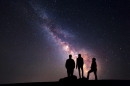 people looking at the night sky