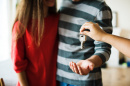 image of person handing couple keys, pexels.com