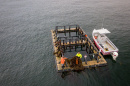 Overhead view of aquaculture pen in ocean