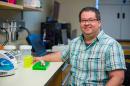 Researcher Matt MacManes seated in his lab