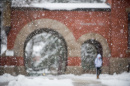 A view of the arch of UNH's T Hall in winter