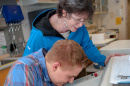 UNH Professor Emeritus Stacia Sower at work with a student