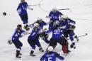 US women's hockey team celebrating winning gold at the Olympics