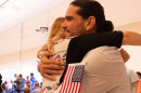New U.S. citizens embrace after swearing in ceremony