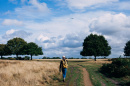 Image of Person Walking through Field
