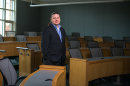 Professor Aktekin poses in a Paul College classroom