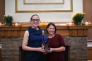 Alley Leach and Jenn Andrews from UNH Sustainability Institute hold their UNH Innovator of the Year trophy