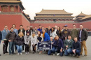 Students pose in front of forbidden city in China