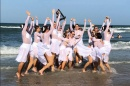 UNH Dance Team celebrating by the ocean