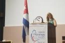 Associate professor of biological sciences and biotechnology Patricia Halpin chairing symposium in Havana, Cuba