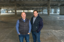 Mike Paglia and Dave Hallal in an empty warehouse