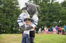 Wildie Cat hugging young boy