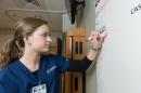 nursing student working on white board
