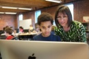 Mihaela Sabin works with a middle school student