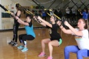 students working out with straps in the gym