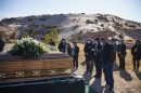 Photo of mourners at a funeral for a victim of COVID-19 held in New Mexico.