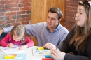 Psychology professor Nick Mian working with student and child in child psychology lab at UNH Manchester