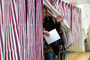 A women exits a voting booth