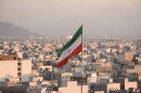 Iranian flag flies above a city in Iran
