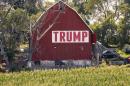 A Trump banner hangs on a barn at a farm in Nebraska in 2018