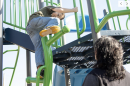 Mom watches her son play on the playground in New Hampshire