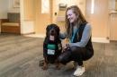 Alexandra Tomwey with a service dog