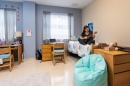 Student plays ukulele in UNH Downtown Commons dorm room