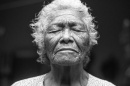 elderly woman with eyes closed