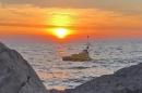 Autonomous boat under a dramatic sunrise