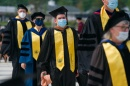 students walking in for commencement
