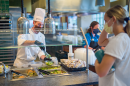 student being served in one of UNH's dining halls