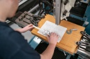 Mechanical engineering technology students works in UNH Manchester machine shop
