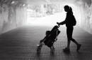 Image of Women Walking Baby in a Stroller