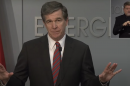 A photograph of North Carolina Governor Roy Cooper during a press conference.