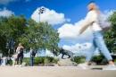Students walking past the Wildcat statue