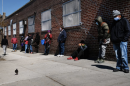 People wait in line to receive assistance