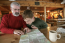 A father and son look at a map of New Hampshire