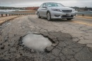 car near pothole