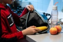 child taking healthy food out of backpack