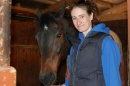 Linsey Phelan '15 with Icing on the Cake, one of her favorite horses, at the UNH horse barns