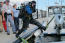 deep sea diver jumps into water