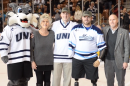 Ryan Pitts, Travis Mills, Wild-Ecat, and supporters on ice.