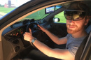 Man driving using Microsoft Hololens augmented reality glasses.