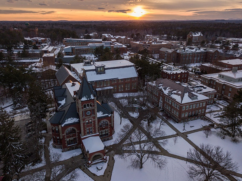 aerial view of UNH's Durham campus at sunset in winter